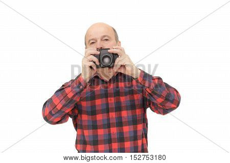 Elderly Man Looks Into The Camera Viewfinder In Search Of The Miraculous Image.