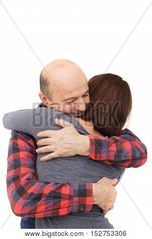 Elderly man hugging his daughter when meeting or parting.
