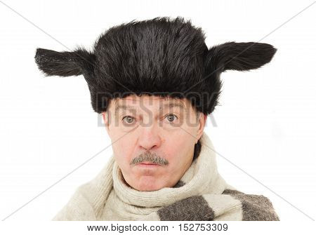 elderly man in warm fur hat with earflaps. Pensioner in russian traditional hat