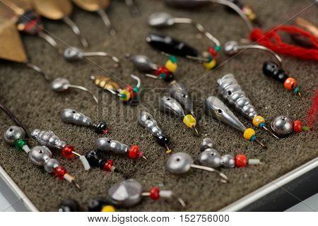 Set of lures for ice fishing, macro shot