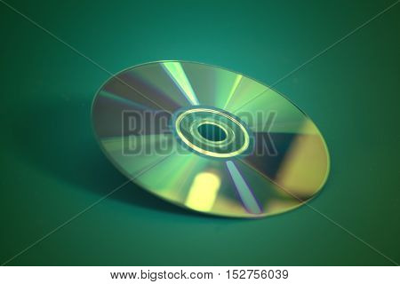 Compact disk CD on a green background