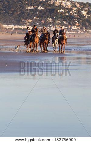 Zahara De Los Atunes, Cadiz, Spain - March 20, 2016: People Having Fun Riding Horses On The Beach