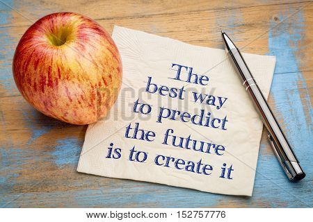 The best way to predict the future is to create it - handwriting on a napkin with a fresh apple