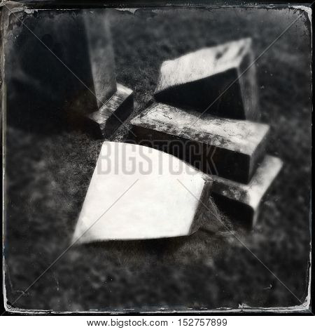 vintage tin type filtered black and white image of a cemetery with blank grave head stone