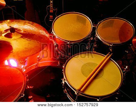 Drummers view of a drum kit on stage before a performance