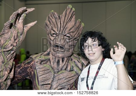 NEW YORK NEW YORK - OCTOBER 9: Person wearing Groot costume with boy at NY Comic Con at Jacob K. Javits convention center. Taken October 9 2016 in New York.