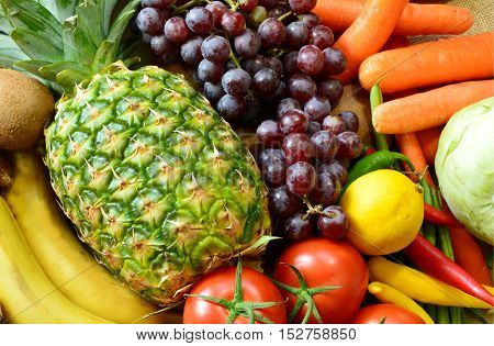 Colorful and various types of vegetables and fruits on sack background