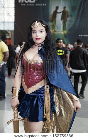 NEW YORK NEW YORK - OCTOBER 9: Woman wearing wonder woman costume at NY Comic Con at Jacob K. Javits convention center. Taken October 9 2016 in New York.