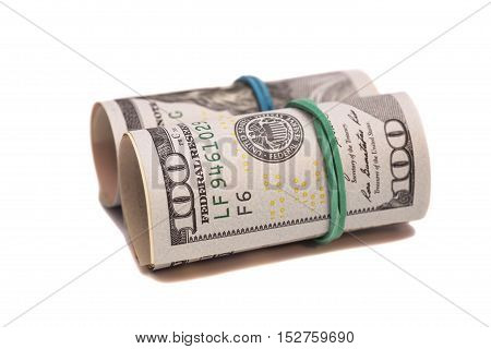 Dollar banknotes roll isolated on white background