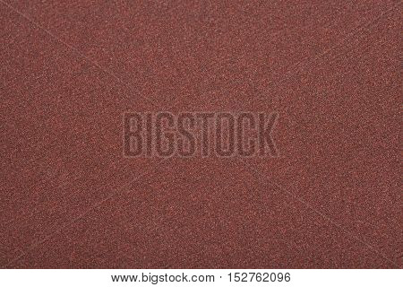 Sandpaper texture abrasive industry detail background brown