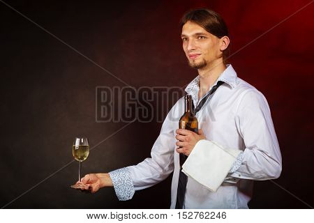 Drink winery liquor relax concept. Waiter serving wine bottle. Steward holds glass with alcohol beverage.