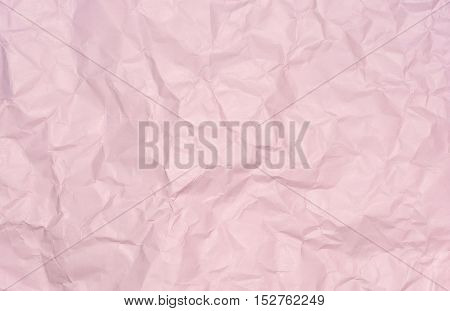 Closeup surface wrinkled pink paper texture background with a little clay stain on paper