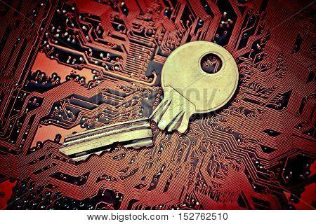 A broken key on computer circuitboard background / computer security breach concept