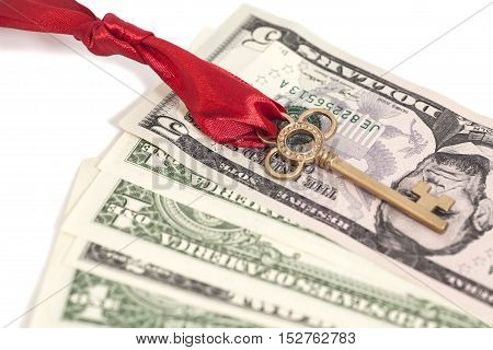 Golden Key With Bow And Dollars isolated