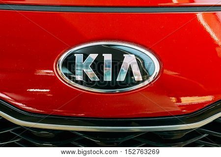 Vilnius, Lithuania - July 08, 2016: Close The Oval Logo Of Kia Motors At The Red Hood Of New Kia Sportage Car, The Compact SUV, Represented In Acropolis Shopping Center.