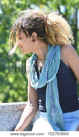 Brazilian hipster woman in a park on a sunny day