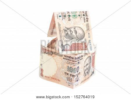 House Made of Indian 1000 rupee banknotes isolated on white