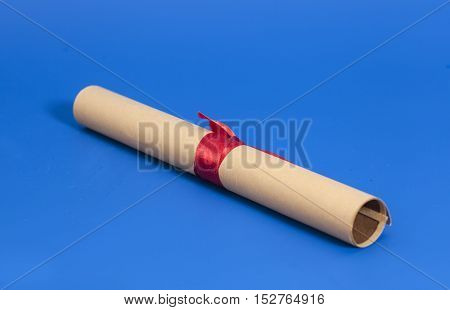 Diploma with Red Ribbon on blue background
