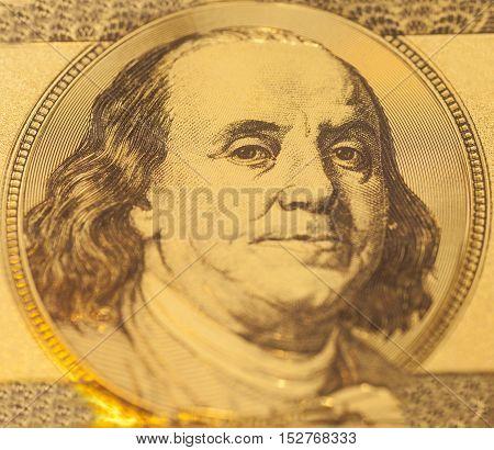 Golden Portrait of Benjamin Franklin on a one hundred dollar banknote
