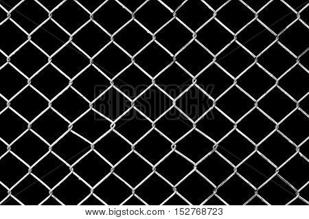 White Chain Link Fence on black background, Black and white abstract closeup of a chain link fence against black background