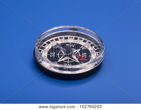 Compass orientation isolated on a blue background