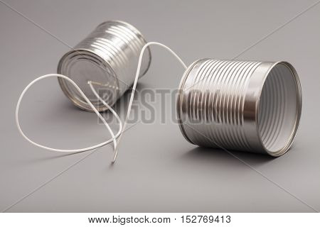 tin can phone on gray background.communication concept