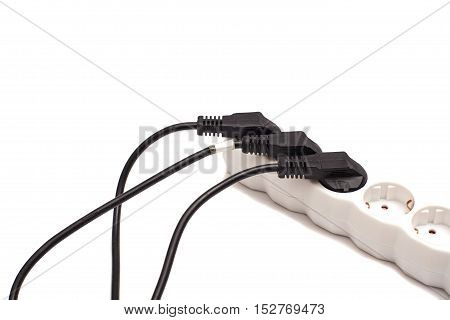 Many plugs plugged into electric power bar isolated on white