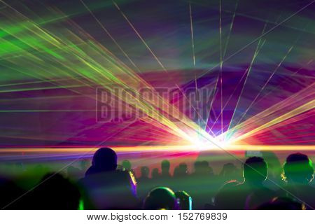 Hyper laser show. Very colorful show with a crowd silhouette and great laser rays on pyrotechnic festival.