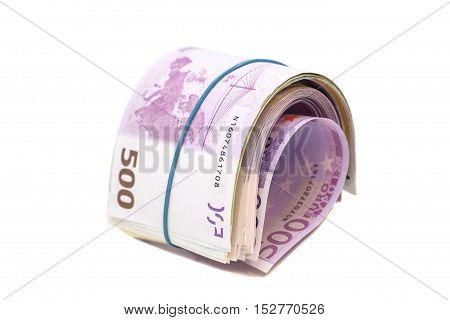 Five hundredth euro banknotes under rubber band isolated
