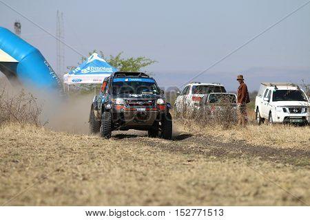 Speeding Black Ford Ranger Rally Car At Start Of Race