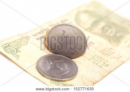 Indian Currency Rupee Notes and Coins isolated on white