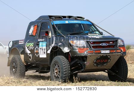 Forty Five Degree Close-up View Of Speeding Black Ford Ranger Rally Car