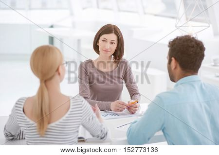 She's got a lot of fresh ideas. Business woman explaining issues to her staff