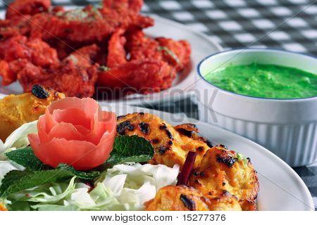 tandoori fish and chicken tikka in plates