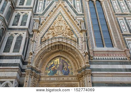 FLORENCE, ITALY - SEPTEMBER 2016 : Annunciation mosaic, carved sculpted angels, Mary in triangular arch on 1 of 4 side Almond doors of Florence Cathedral in Florence, Italy on September 21, 2016.