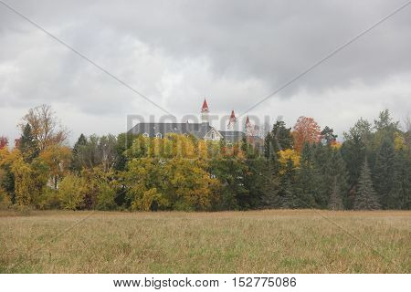 Fall colors with the towers of an old mental hospital in Traverse City, Michigan