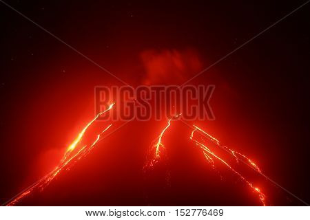 Volcanic landscape of Kamchatka Peninsula: night view of eruption Klyuchevskoy Volcano current lava flows on of volcano. Eurasia Russia Far East Kamchatka Klyuchevskaya Group of Volcanoes.