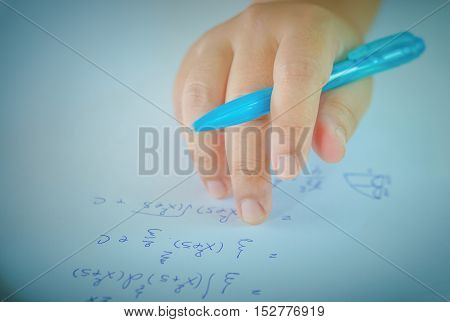 Student testing in exercise exams with blue pen on advanced mathematics (maths) in vintage style