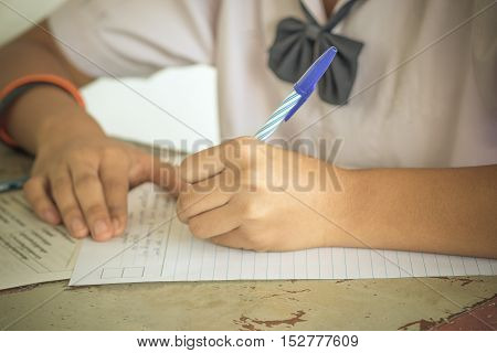 Blurred of Thai student writing a test in exercise Exams.