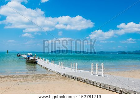 The beach and floating dock with blue sky on a sunny day