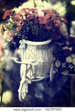 Close up of flower in vase with vintage tone filter.
