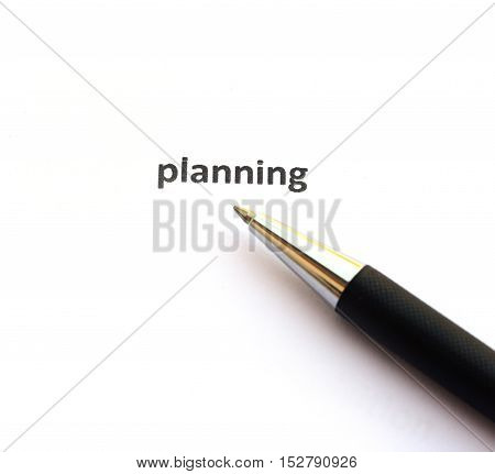 Planning with pen isolated on white background.