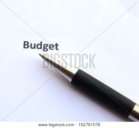 budget with pen isolated on white background.