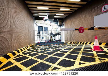 Parking Garage Underground Interior Of Yellow Zebra Crossing