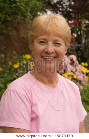 Happy grandma outside in her garden.