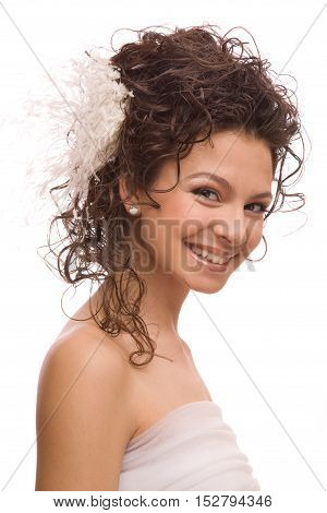 Young beautiful cheerful modern bride with feather hairpin in her hair isolated on the white background