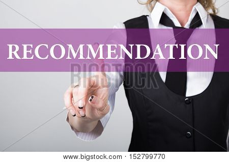 recommendation written on virtual screen. technology, internet and networking concept. woman in a black business shirt presses button on virtual screens.