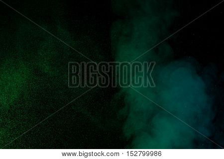 Abstract green water vapor on a black background. Texture. Design elements. Abstract art. Steam the humidifier. Macro shot.