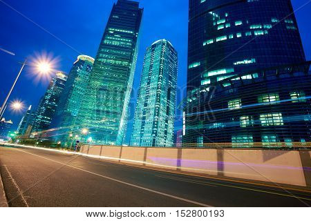 Road Light Trails On Streetscape Office Buildings In Shanghai