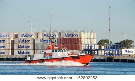 Oakland CA - September 26 2016: Pilot Vessel GOLDEN GATE. An experience pilot is critical for guiding the huge ships in and out of the Port of Oakland.